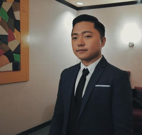 Jake Zyrus in a black suit.