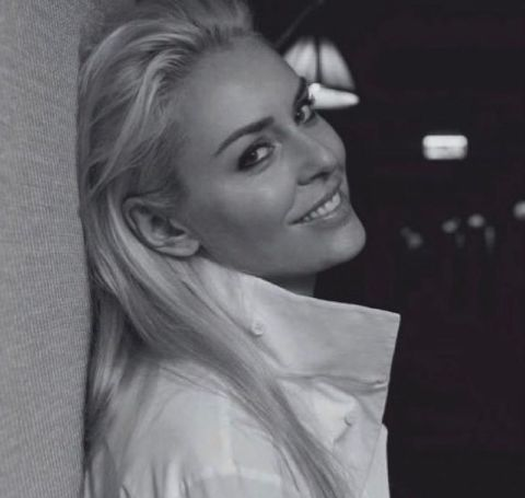 Lindsey Vonn in a white shirt poses for a photoshoot.