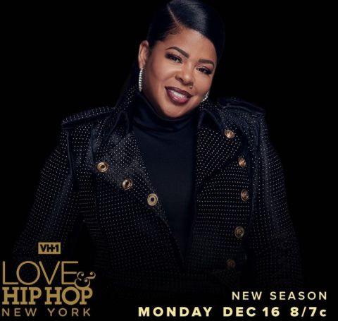 Chrissy Lampkin in a black dress poses at the cover of VH1 series Love and Hip Hop: New York