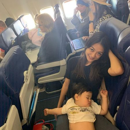Karen Riotoc with her baby in a plane.