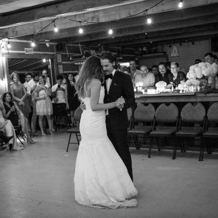 Linzey Rozon dancing on her wedding day with her husband.