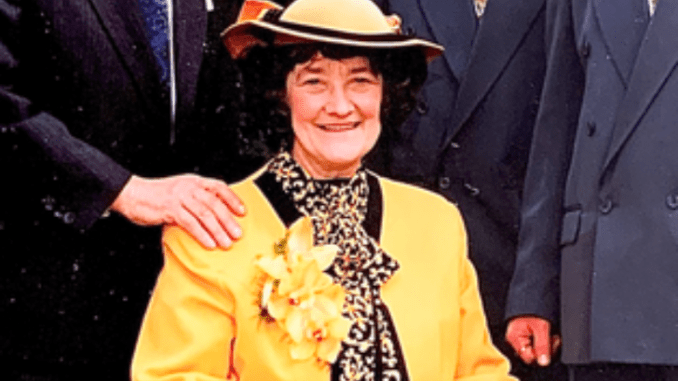 Irene Mary Taylor posing for a picture in a yellow clothing