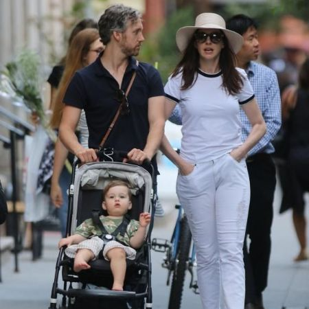 Adam with his wife, Anne Hathaway, and their son