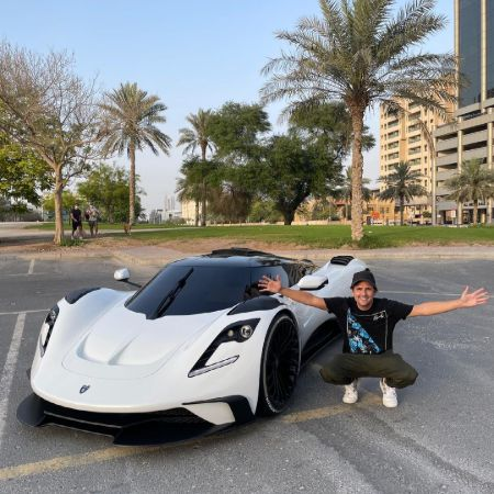 Nik Hirschi in front of his Ares S1 Hypercar