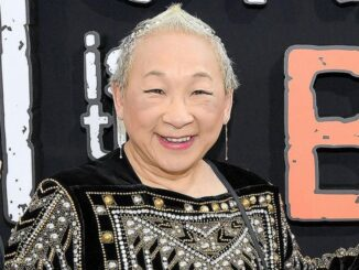 Lori Tan Chinn smiling and posing for a photo