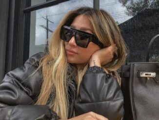 Joanna Zanella wearing sunglasses and posing for a photo.