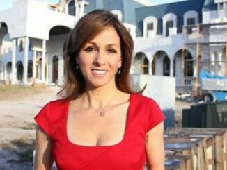 Janet Shamlian wearing a red dress and posing for a photo.