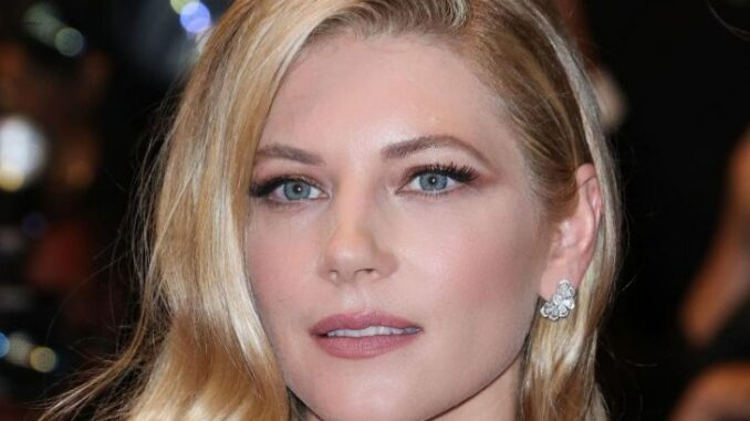 Katheryn Winnick posing for a photo at an event.